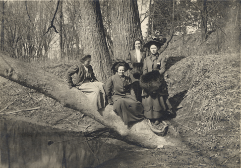 Four students on the Red Cedar, ca. 1910