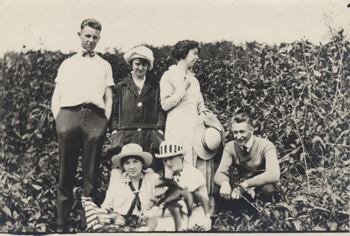 Five students pose, date unknown