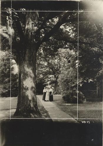 Four women on campus, ca. 1920