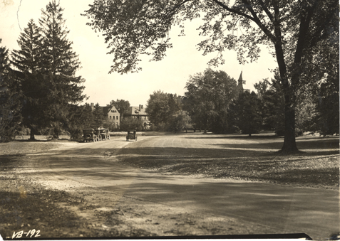 Cars driving towards campus, 1923