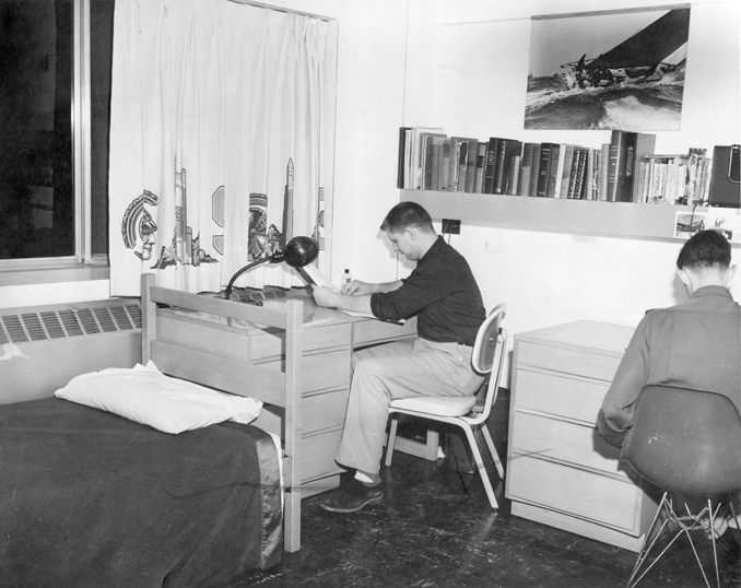 Two men study in their dorm room, ca. 1955