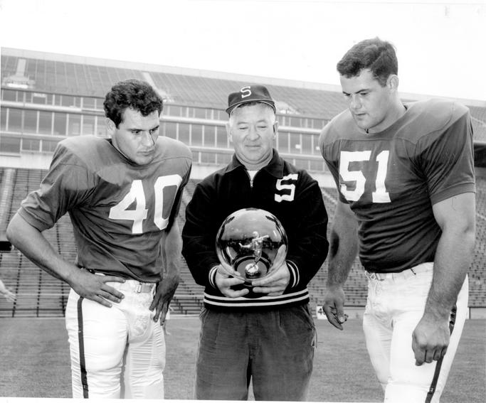 Coach Daugherty and two place gaze into crystal ball, 1962