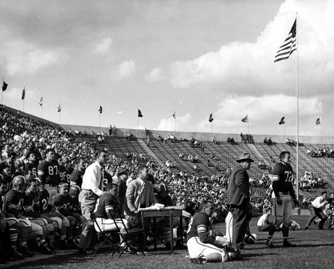 Captain Voegler and the coach on the sidelines, 1950