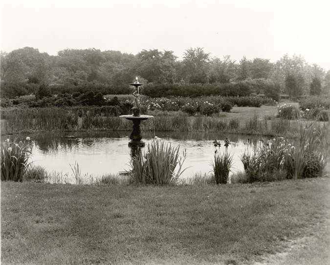 Campus fountain in a pond, date unknown