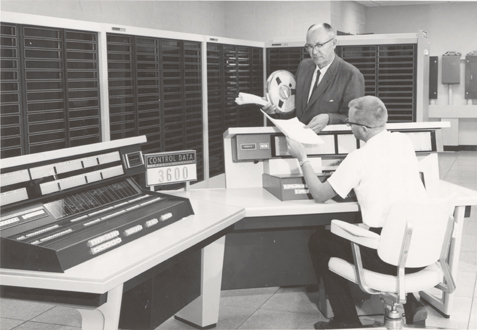Dr. L.H. Brown examining data in the Computer Center, 1963