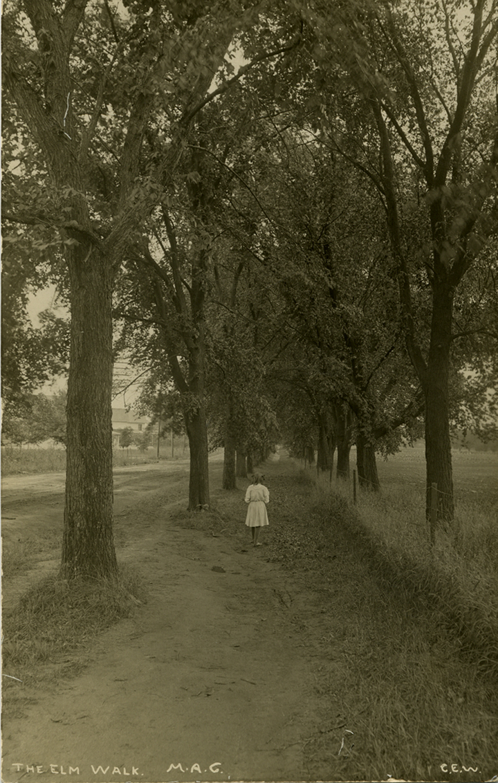 Girl walking down a path, date unknown