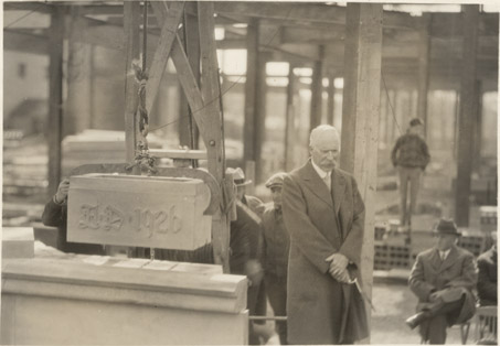 Frank Kedzie next to the cornerstone of Kedzie Hall, 1926