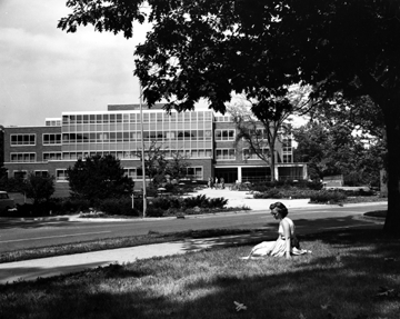 A student reads outside of the Library, circa 1958