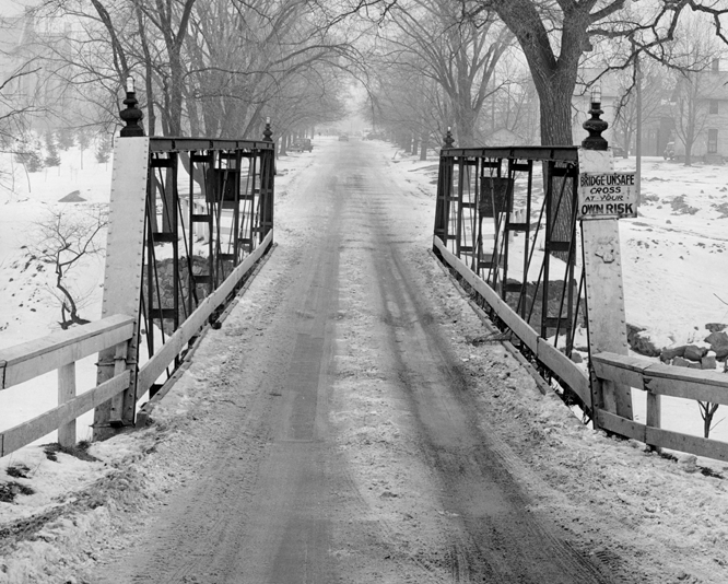 A snow covered bridge on campus, date unknown