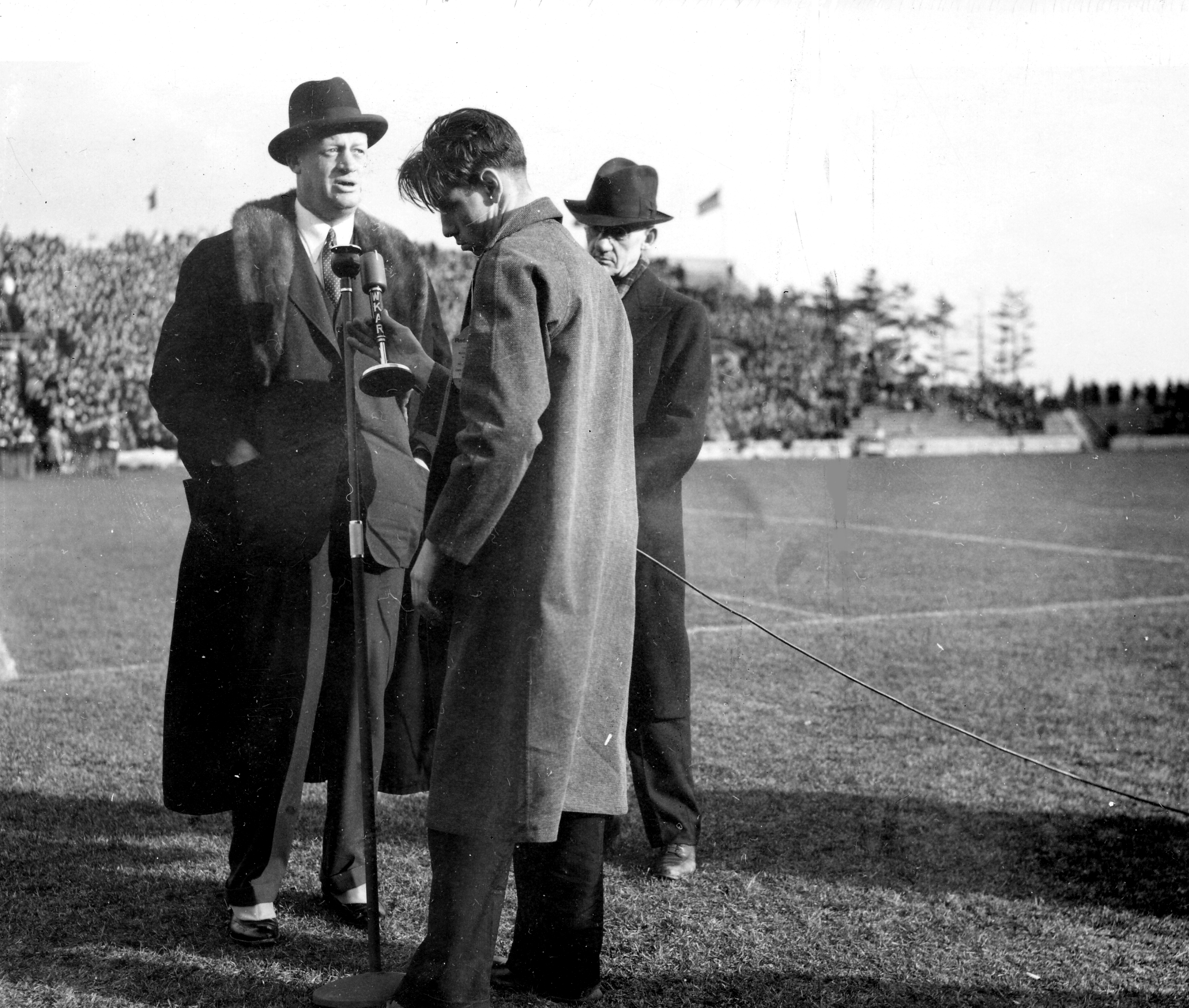Coaches Macklin and Shaw address a crowd, date unknown