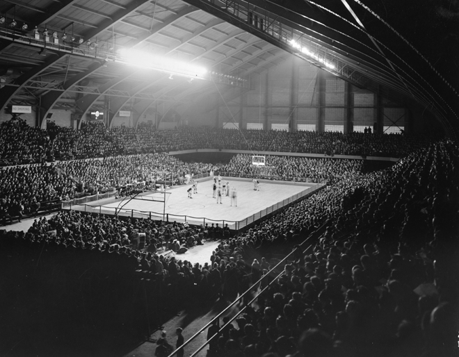 A large crowd watches an MSU basketball game, 1940