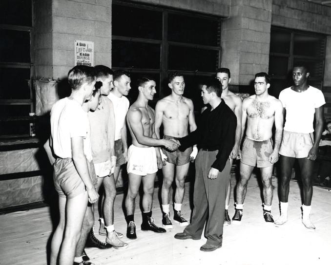 Jed Black congratulates IM boxing winners, 1954