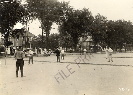 Men playing a tennis game along E. Grand River, 1920 ca.
