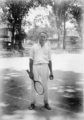 A tennis player poses, date unknown