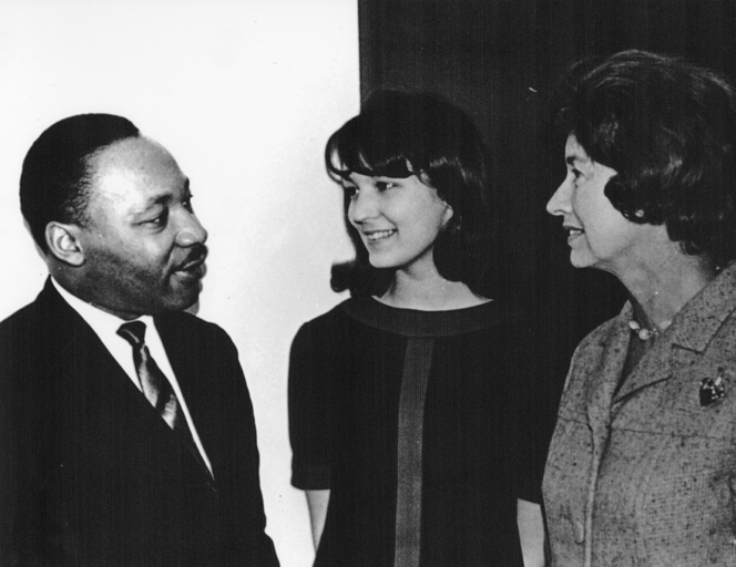 MLK Jr. speaks with two women, 1966