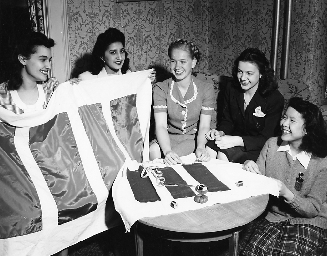 Students sew with the International Club, date unknown