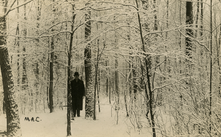 Man standing in the Aboretum during the winter, date unknown