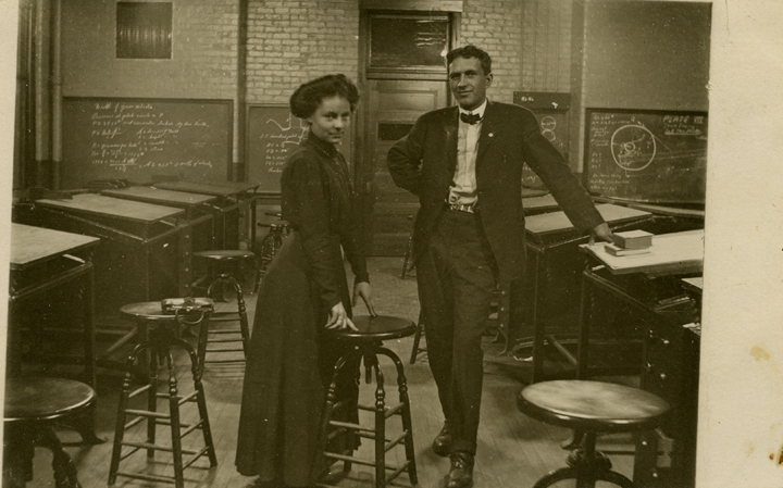 A man and woman in a classroom, date unknown