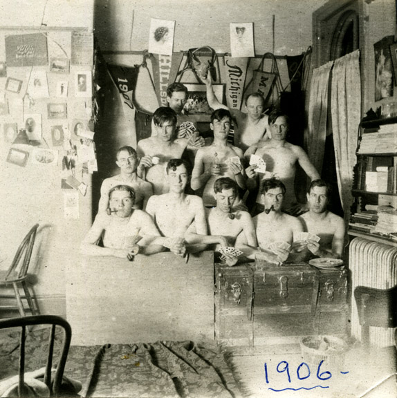 Shirtless male students in a dorm room, 1906