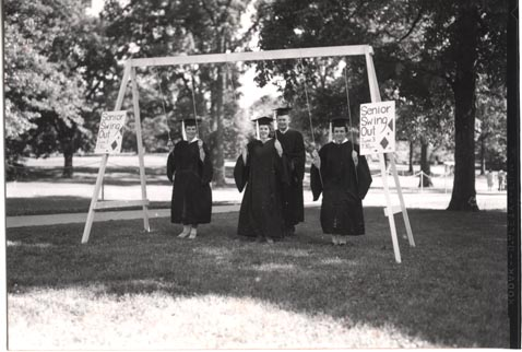 "Students on Swings with ""Senior Swing Out"" Signs, date unknown"