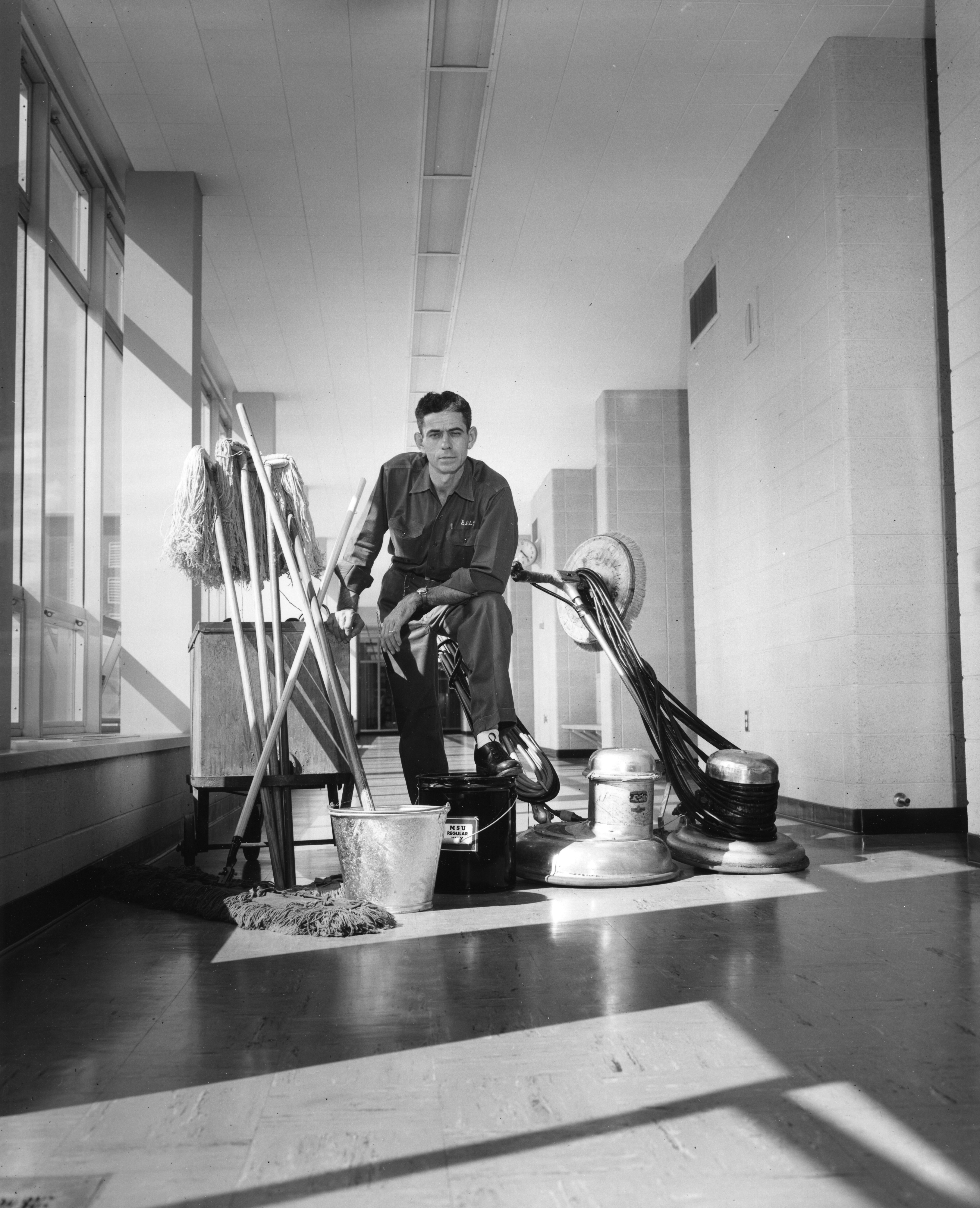 A custodian with supplies, 1958
