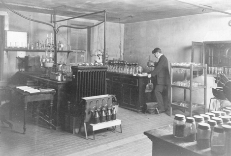 A student works in the Chemistry Lab, 1897