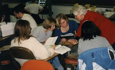 Margaret Zee Jones assists four female medical students, 1999