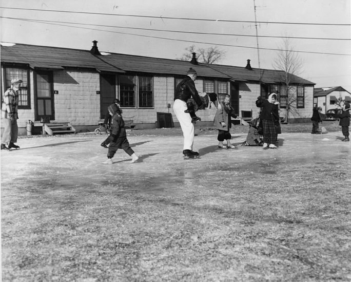 Families ice skating, 1954