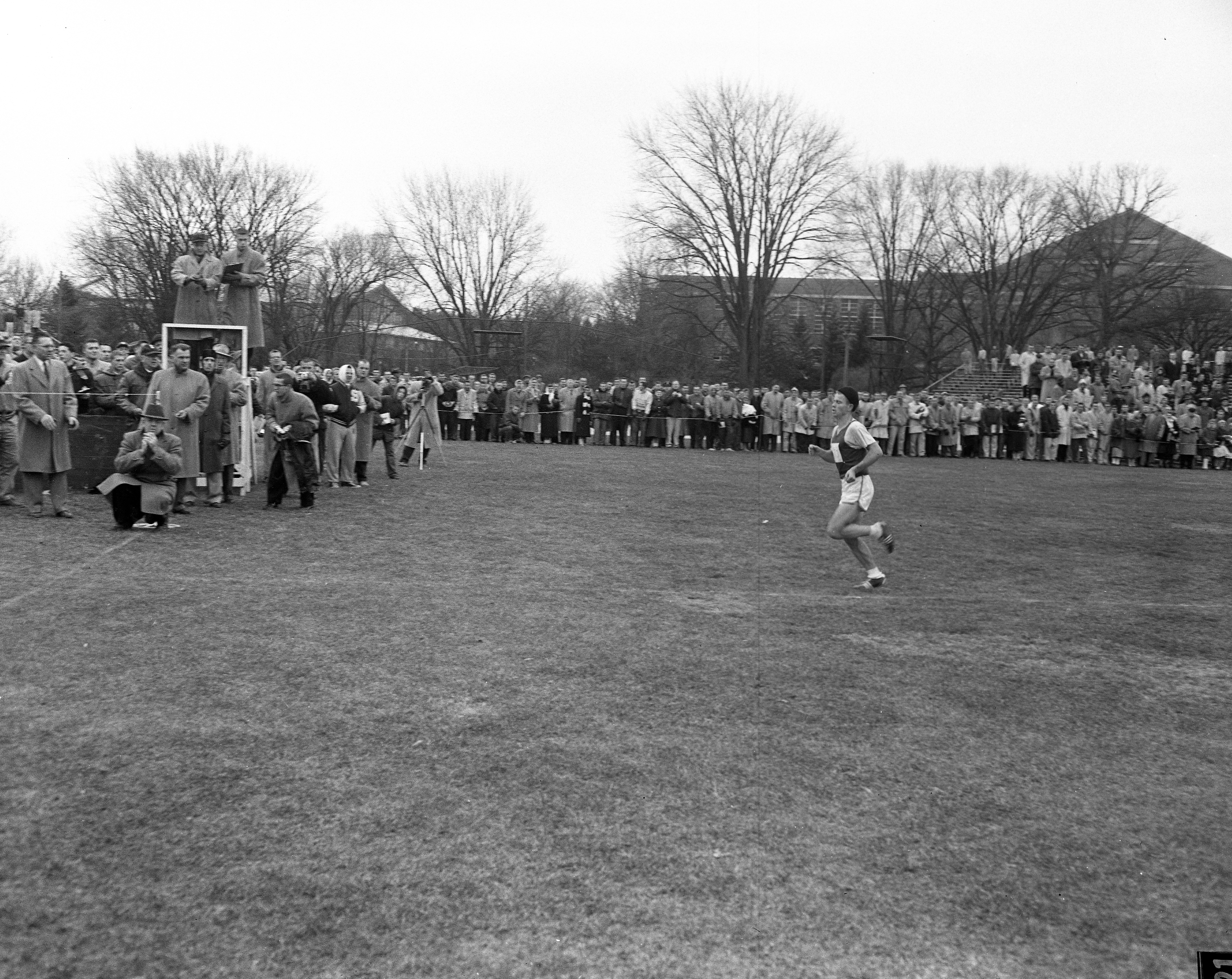 Cross country runner on course, 1957