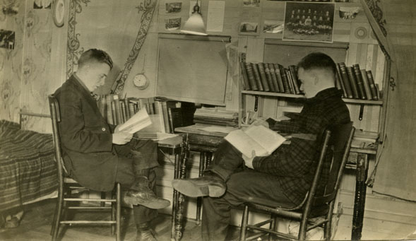 Two Male Students Reading in a Dorm Room