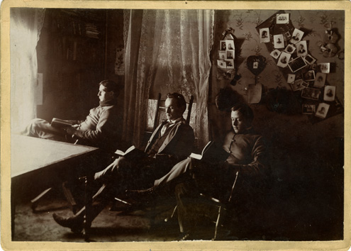 Three Male Students Reading in a Dorm Room