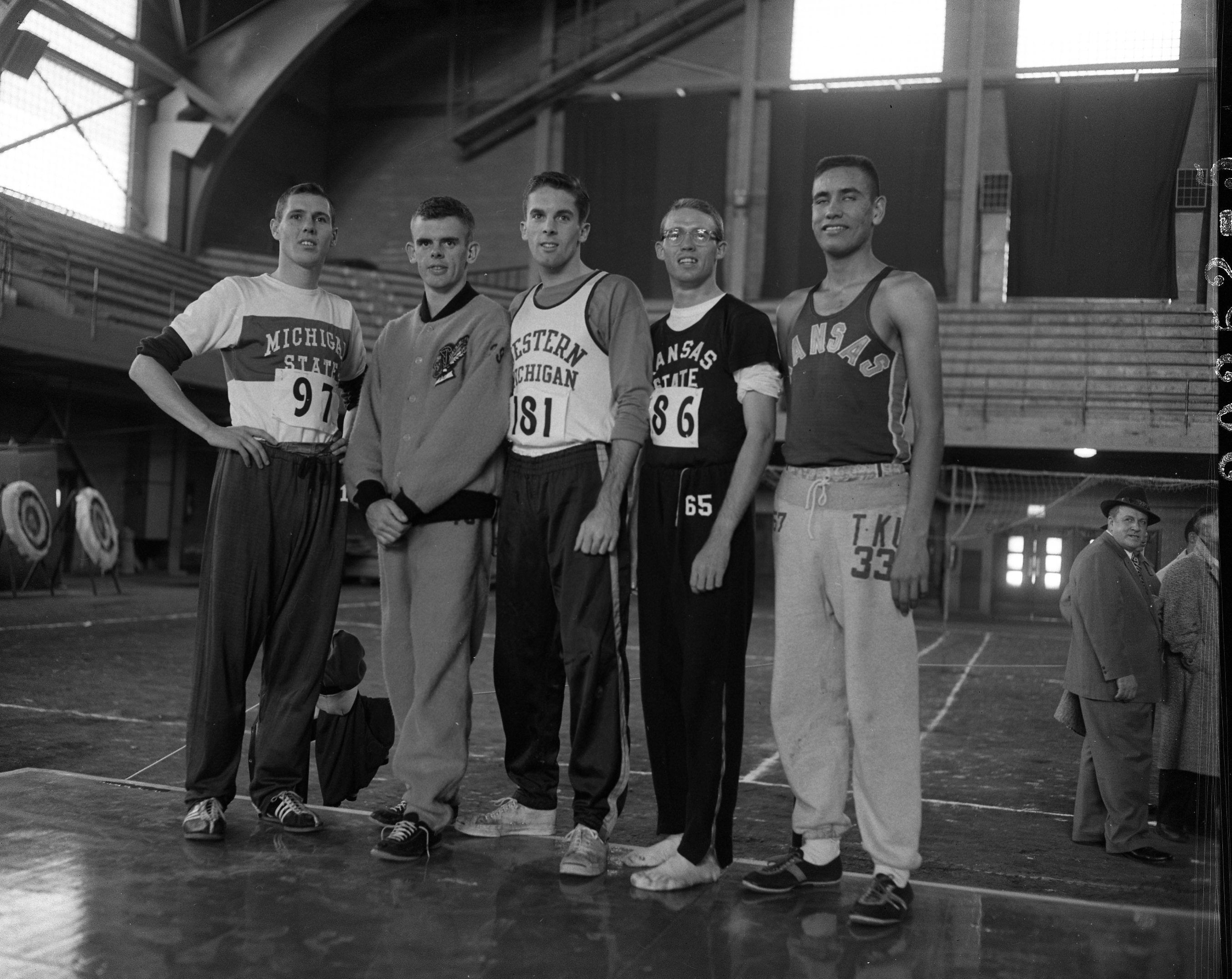 Cross Country team members in Jenison Field House, circa 1950s