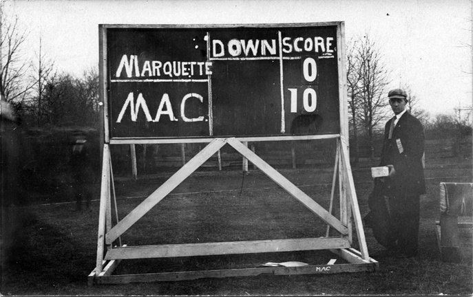 Scoreboard from a M.A.C.-Marquette football game, 1909