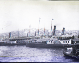 Docked boats, date unknown