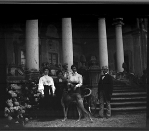 A Family in Front of House , date unknown