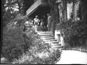 Group of people on porch, date unknown