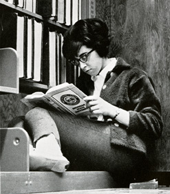 Coed studying in the library