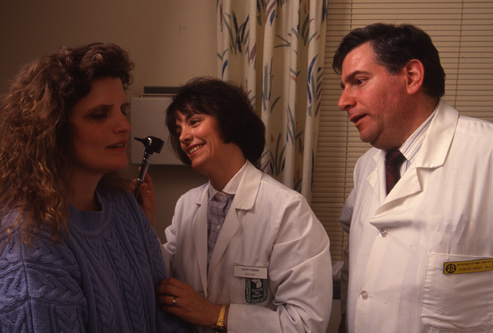 Dr. Howard Brody, CHM student Kathy Fenske and patient