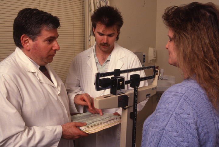 Dr. Howard Brody with unidentified CHM student and patient, circa 1992