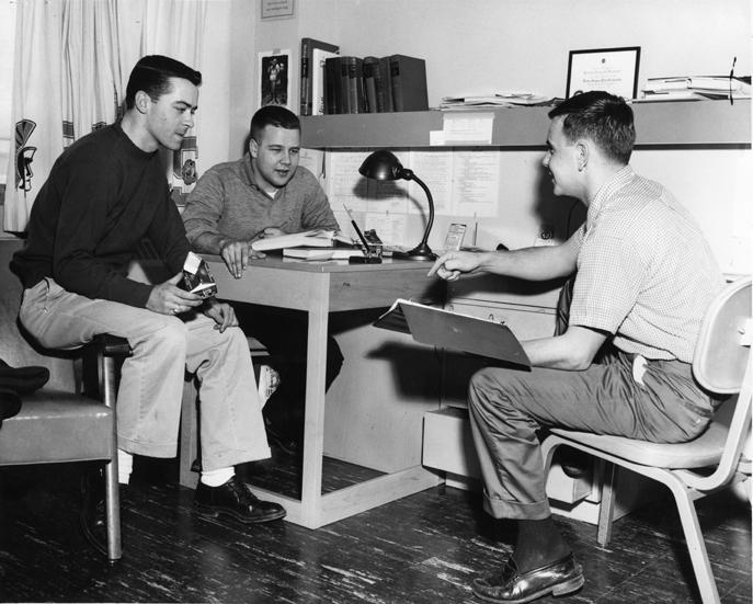 Men studying, 1950s