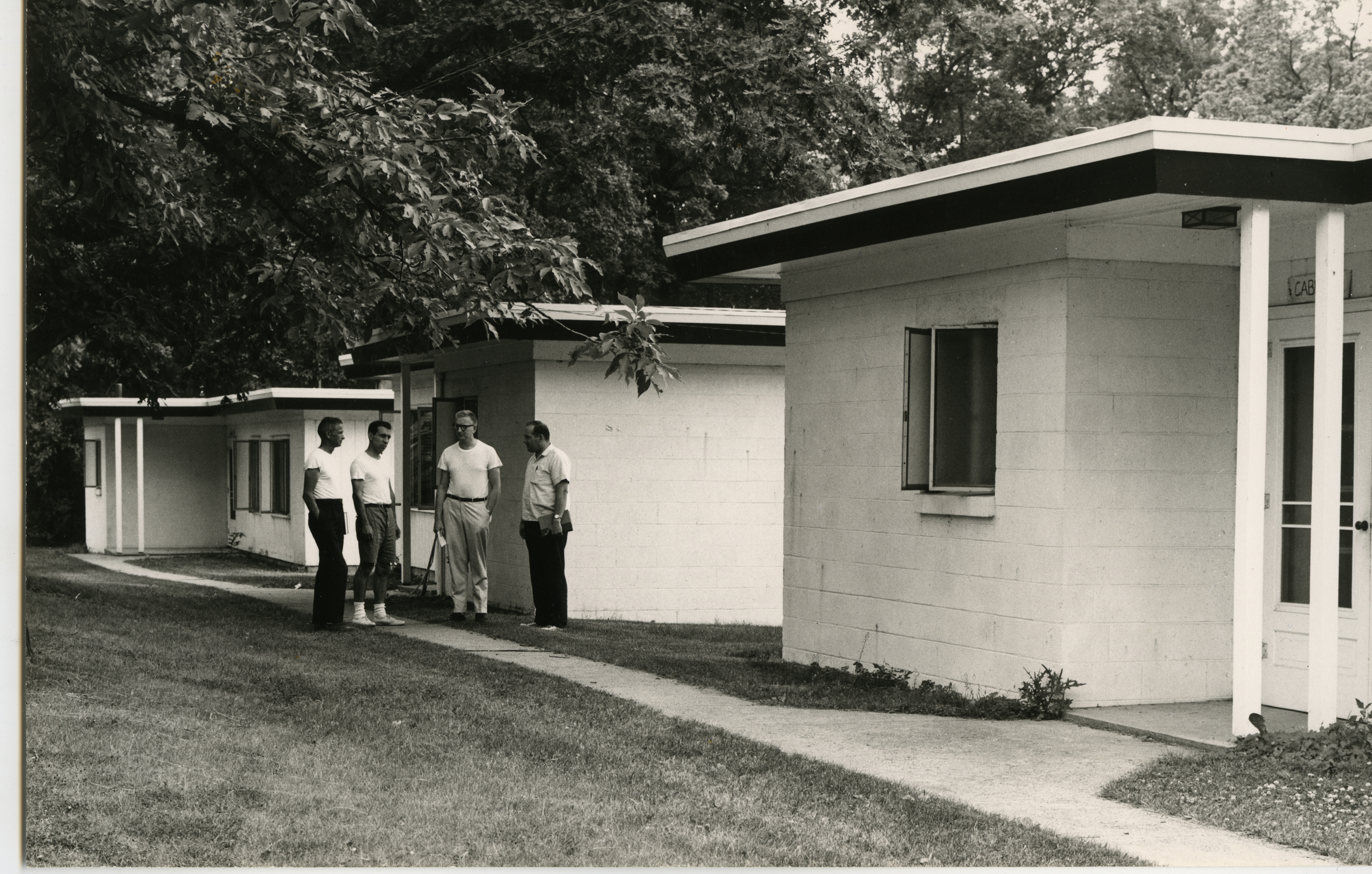 Men standing outside buildings at KBS, 1973