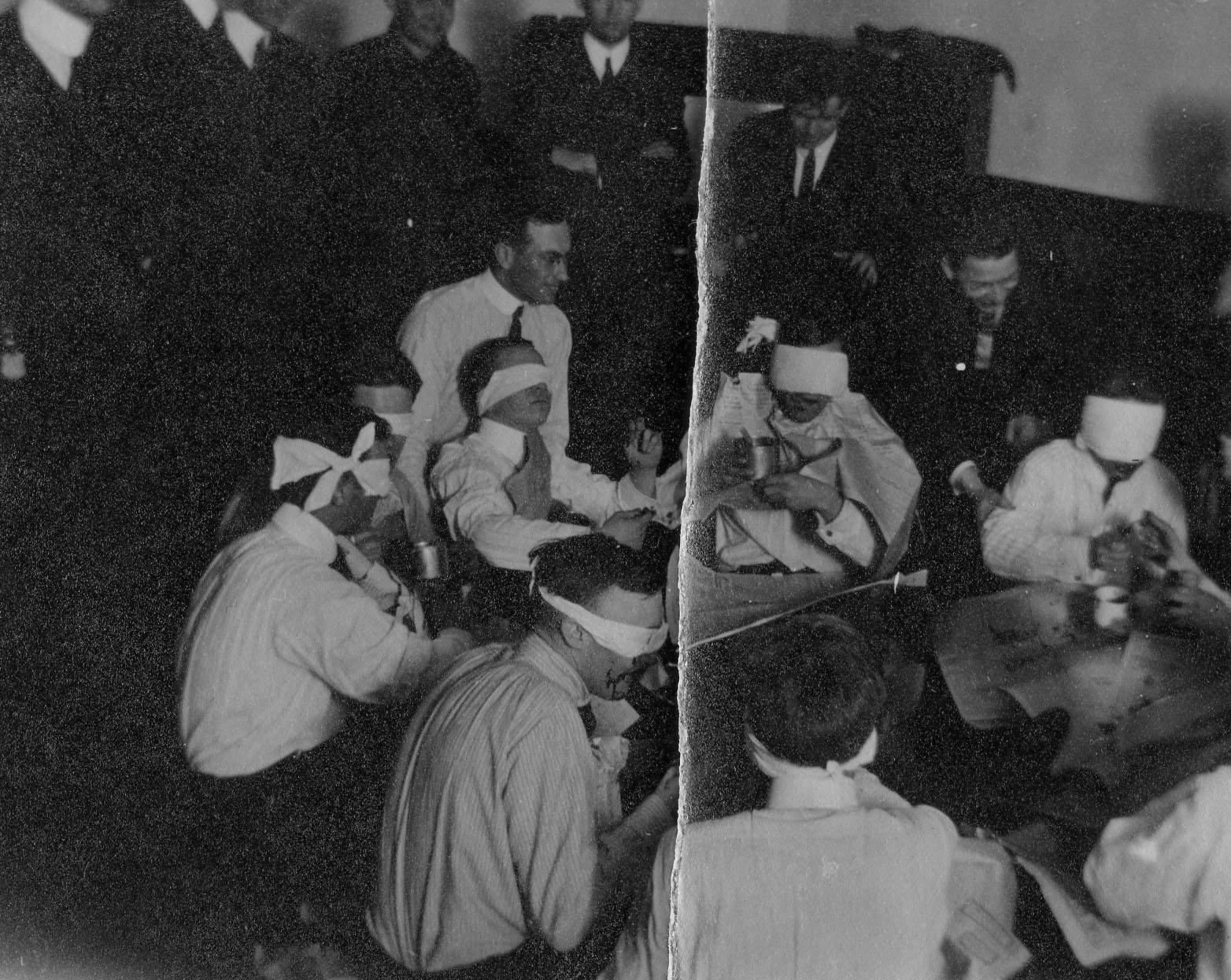 Men eating while blindfolded, c. 1911-1914