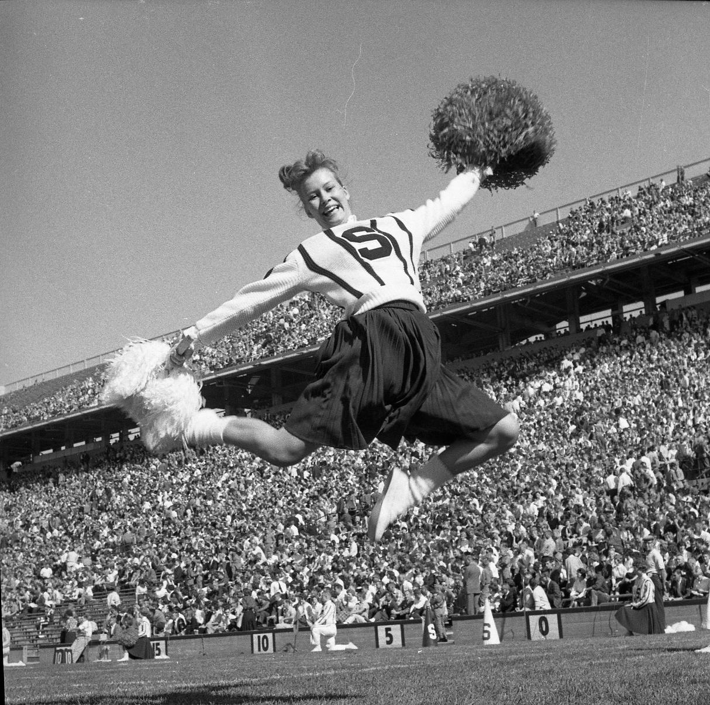 Cheerleader in Action on Gameday, 1961