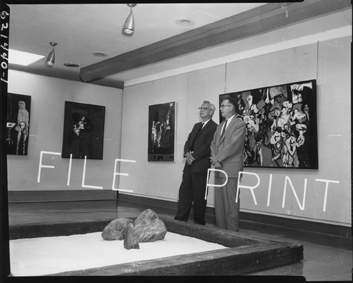 Doctors Paul Varg and Erling B. Brauner discuss paintings, 1962