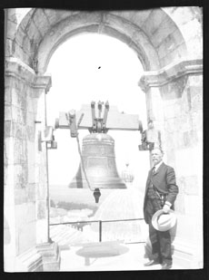 Man standing next to a bell (Frank M. Benton papers), circa 1880s