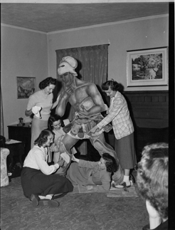 Co-eds work on a Spartan statue for homecoming, 1948
