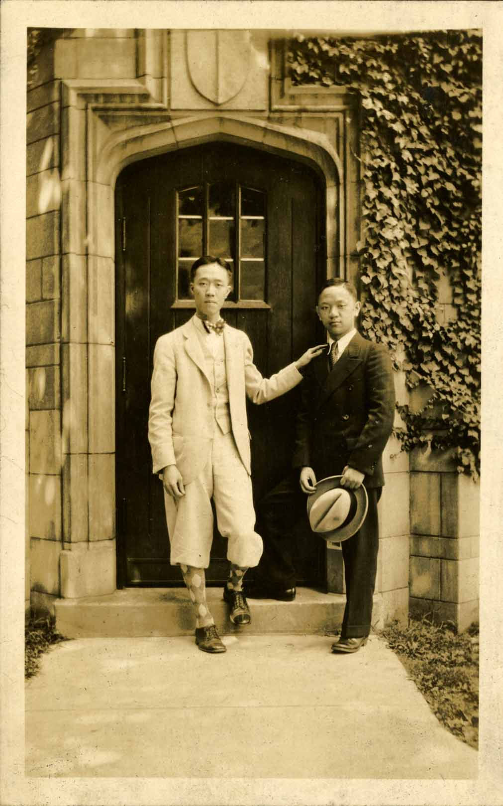 Onn Mann Liang posing with an unidentified man, 1928