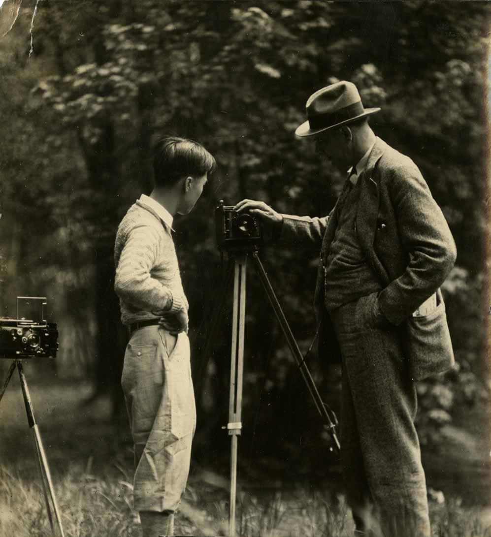 Onn Mann Liang inspecting camera, circa 1924