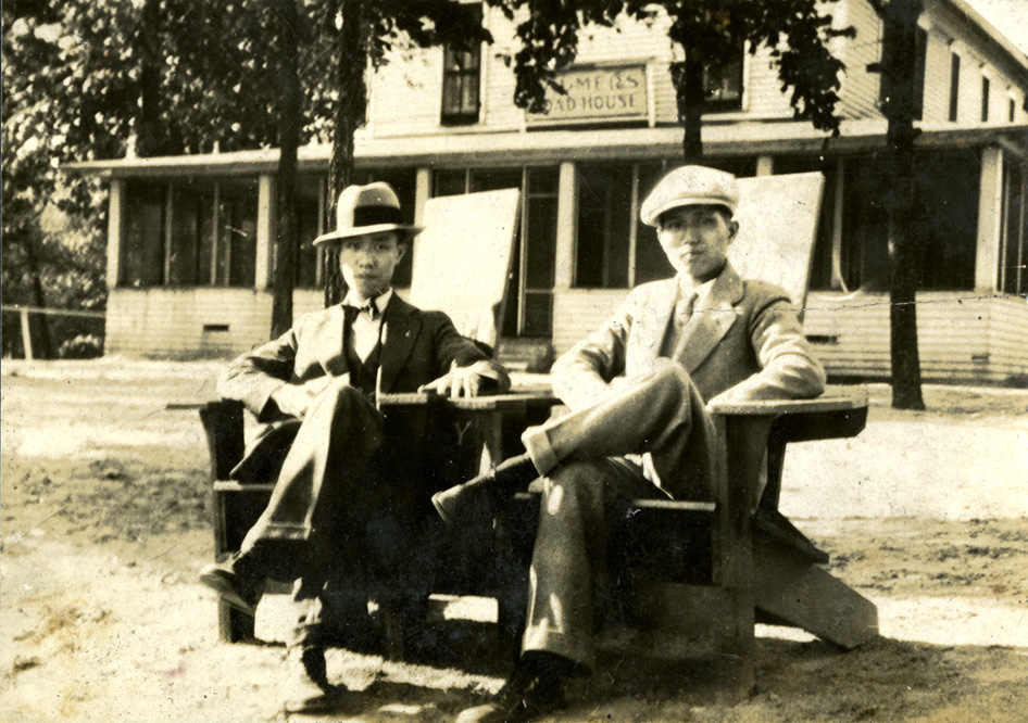 Onn Mann Liang seated outside a house with unidentified man, circa 1925