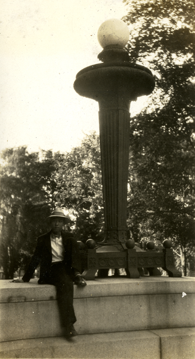 Onn Mann Liang posing next to a lamp post, 1927